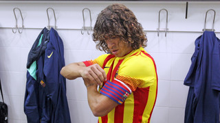 Carles Puyol with the captain's armband