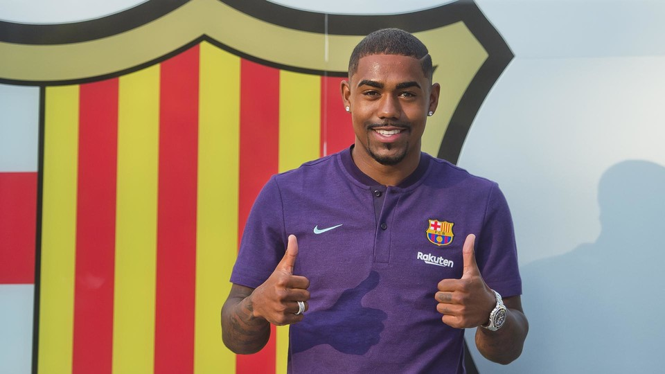 Malcom in the traditional new-signing pose with the club crest