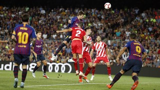 Sending off for Lenglet hinders home side in 2-2 draw against Girona. Messi and Piqué find the net for the Blaugrana