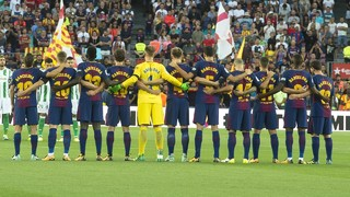 The Barça players take part in an emotional minute's silence with the Betis players and the fans in the stadium whilst 14 seats are left empty in the President Suñol box in memory of those who died in the terrorist atrocity