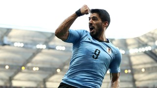 The blaugrana star scores in 23rd minute in the Uruguay v Saudi Arabia game as his strike secures a 1-0 victory and a place in the round of 16 at the World Cup