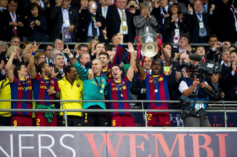 Eric Abidal lifting up the Champions League trophy in 2011